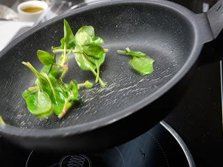 Melvin restaurant creates a spinach garnish for its chicken dish